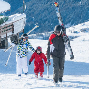 Family skiers at Saint-Francois Longchamp, French Alps