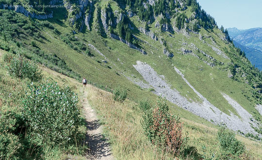 View of walker on mountain footpath in Summer above Chatel