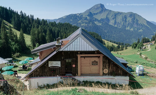 View of chalet restaurant with with mountains above Chatel