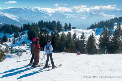 Skiers looking at mountain scenery above Les Gets, French Alps