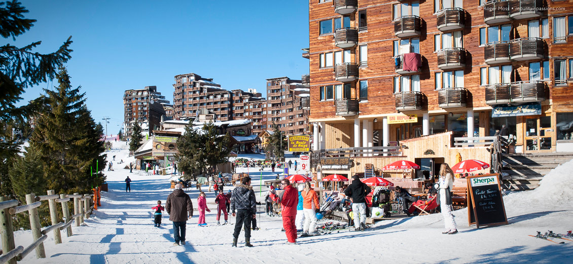 Skiers and other visitors with ESF ski instructor in Avoriaz, Portes du Soleil, French Alps.