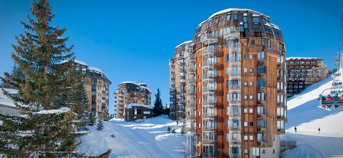 Skier's-eye view from chairlift passing apartment blocks in Avoriaz, Portes du Soleil, French Alps.