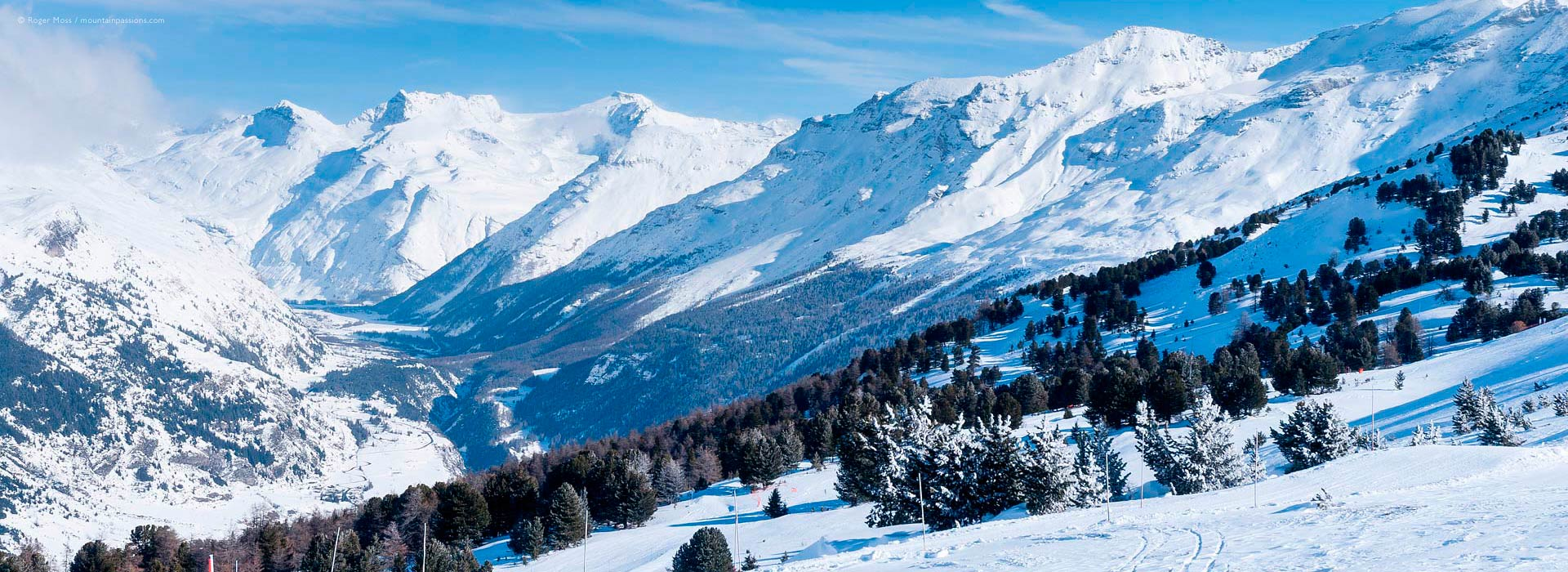 Wide view of mountainside with snow-covered Haute Maurienne valley at Val Cenis Vanoise