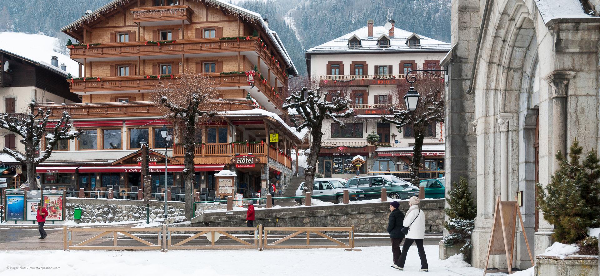 Village church and hotels after snowfalls.