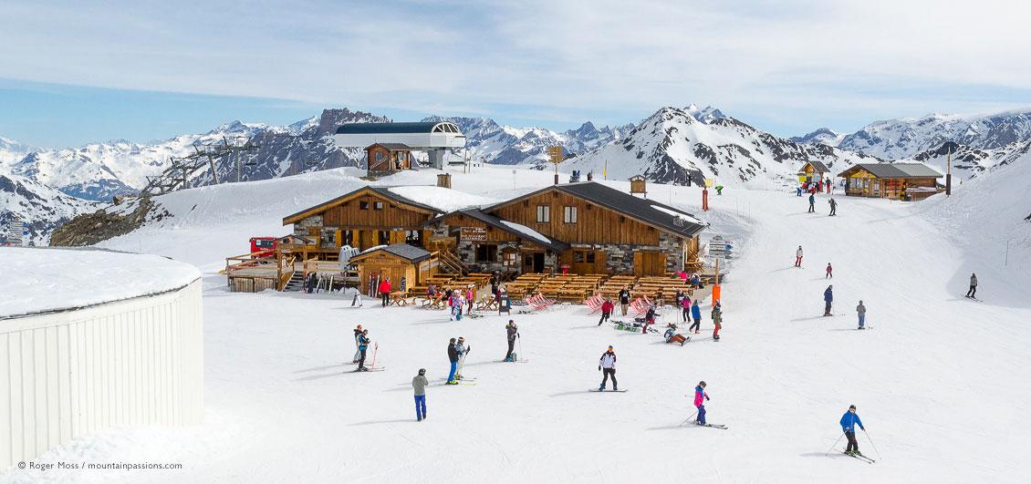 Skiers around mountain restaurant