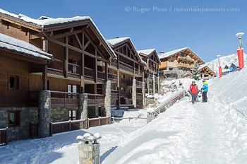 Skiers returning to slopeside apartments at Sainte Foy Tarentaise, Savoie, French Alps.