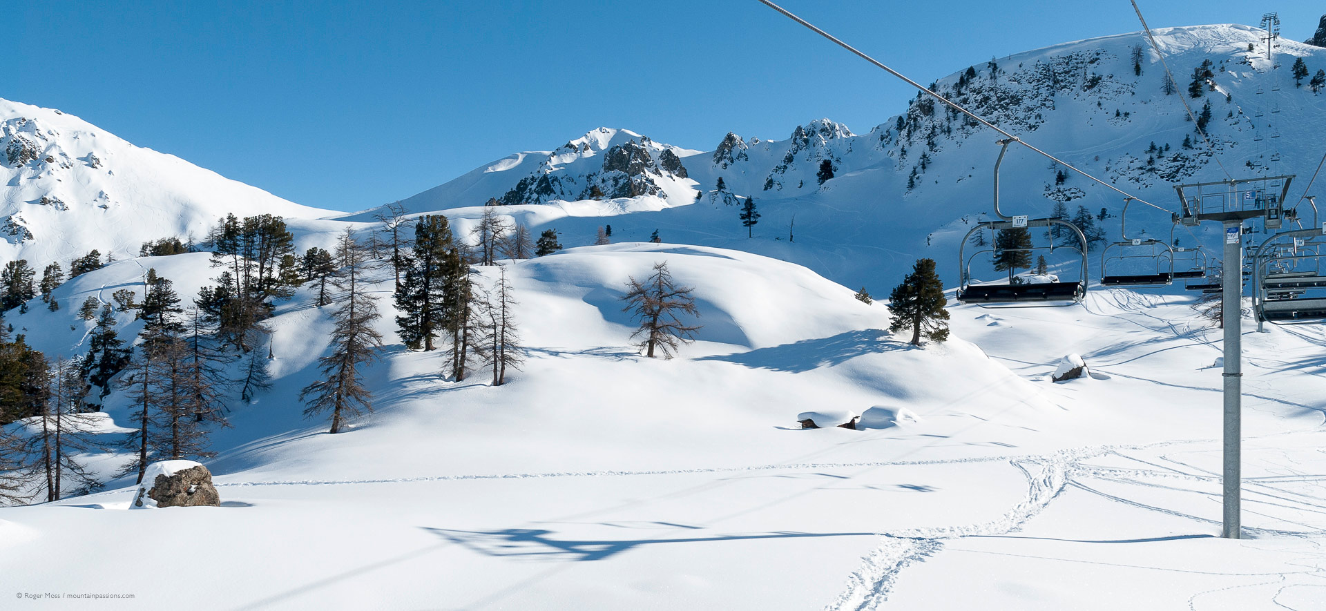 Fresh snow and natural mountain scenery seen from ski lift