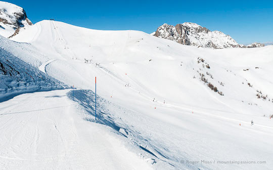 Wide view from ski piste of mountain with ski lift