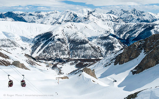 Overview of mountains with ski village in valley