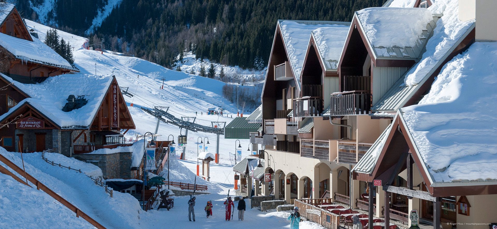 View through ski village to mountainside with visitors