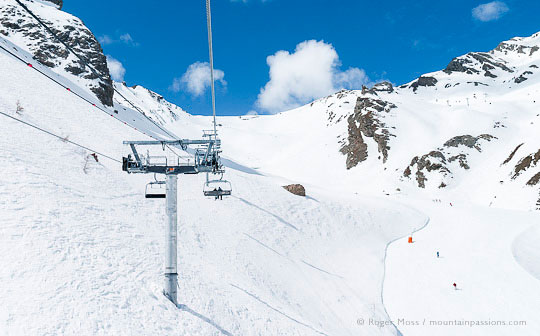 Skier's view from chairlift of pistes