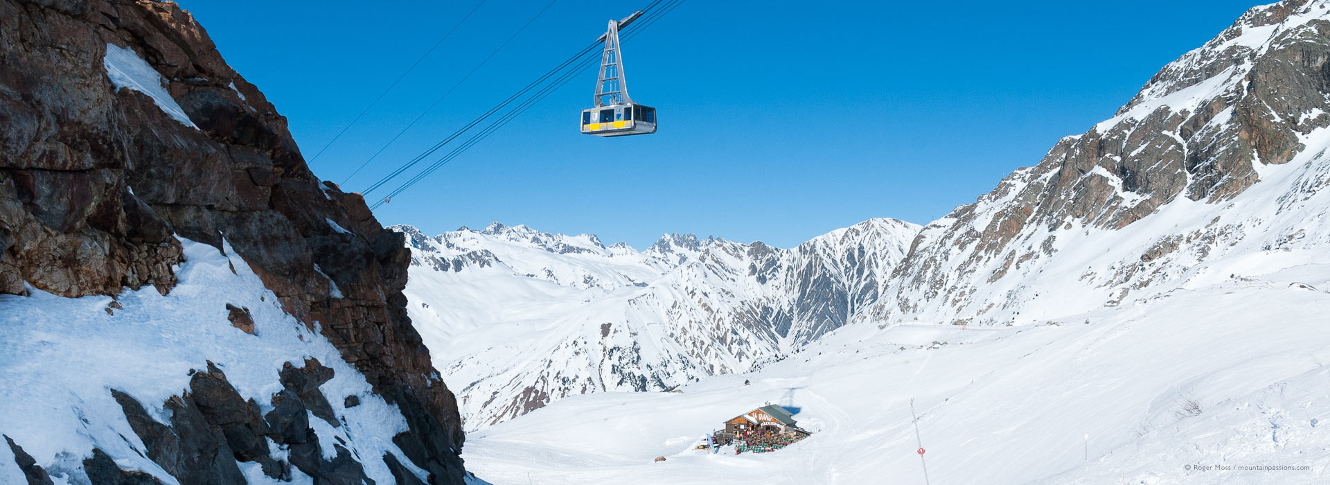 Wide view of mountains with cable car above Vaujany