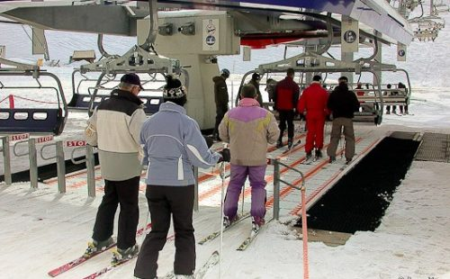 Loading area of a six-seater magic-carpet chair-lift in Tignes, in the Espace Killy (French Alps).