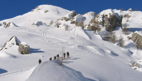 Ski touring group ascending to Palastre.