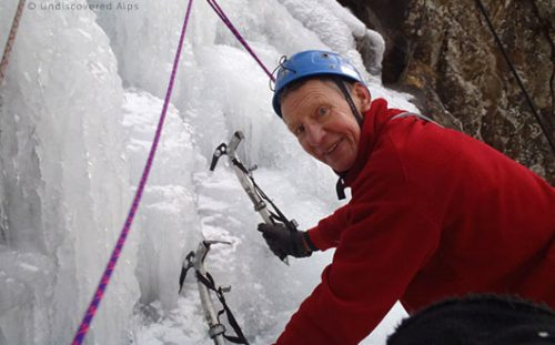 Male ice-climber with equipment detail