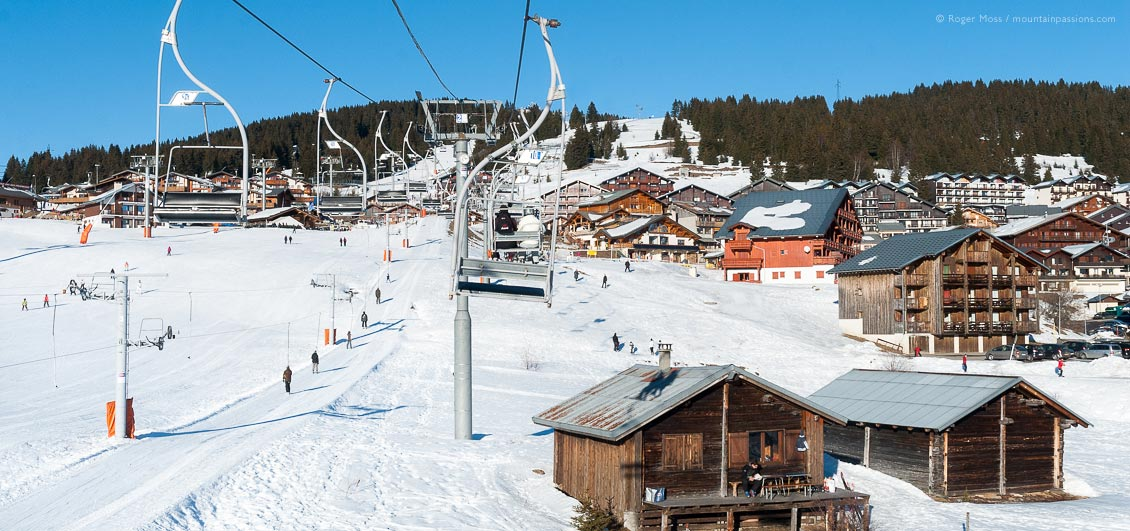 View from chair-lift of skiers and village of Les Saisies