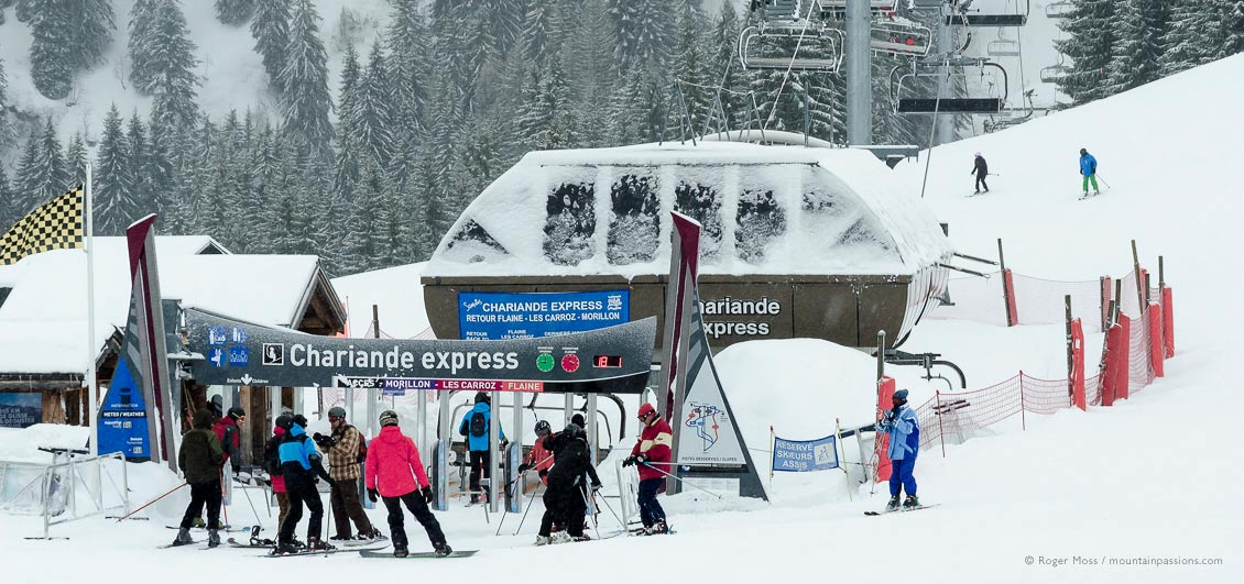 Skiers joining ski lift at Samoens 1600, Grand Massif, French Alps.