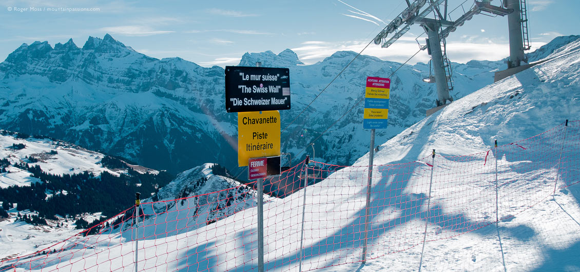 View of mountains with Swiss Wall piste sign and ski-lift at Avoriaz