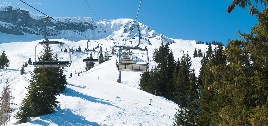 Elevated view from chair-lift of mountainside with skiers at Megeve