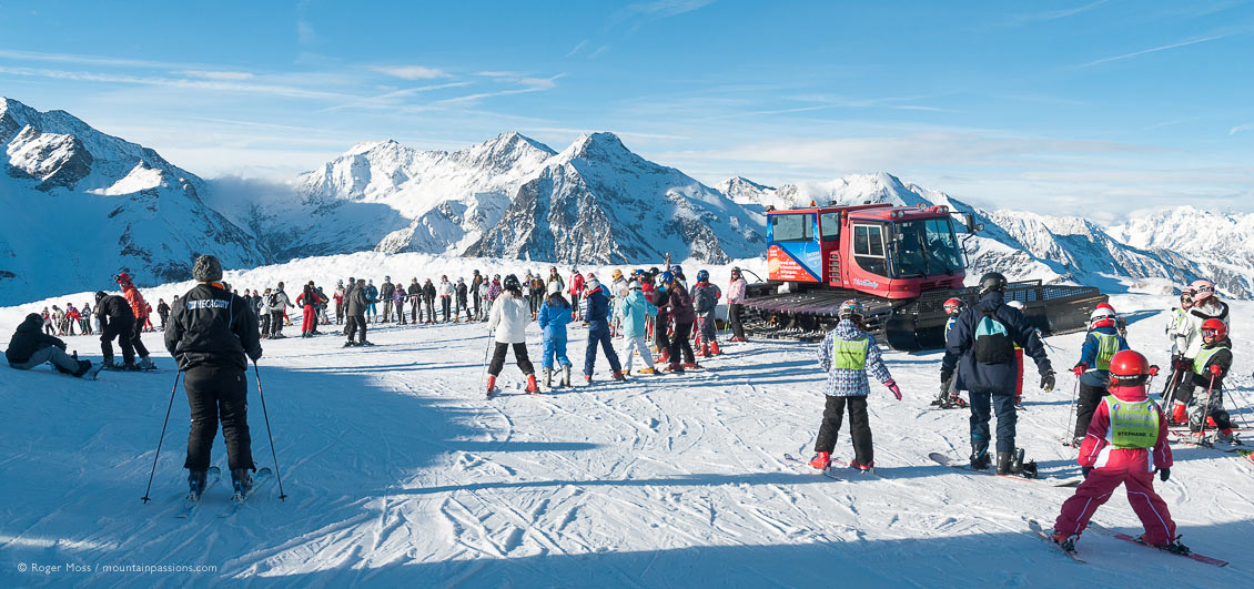 Wide view of young skiers gathered for ski lessons at Peyragudes, French Pyrenees