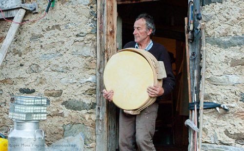 Jean-Pierre Blanc carrying a newly-made Beaufort cheese