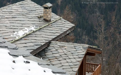 Overview of lauze stone roof of mountain chalet