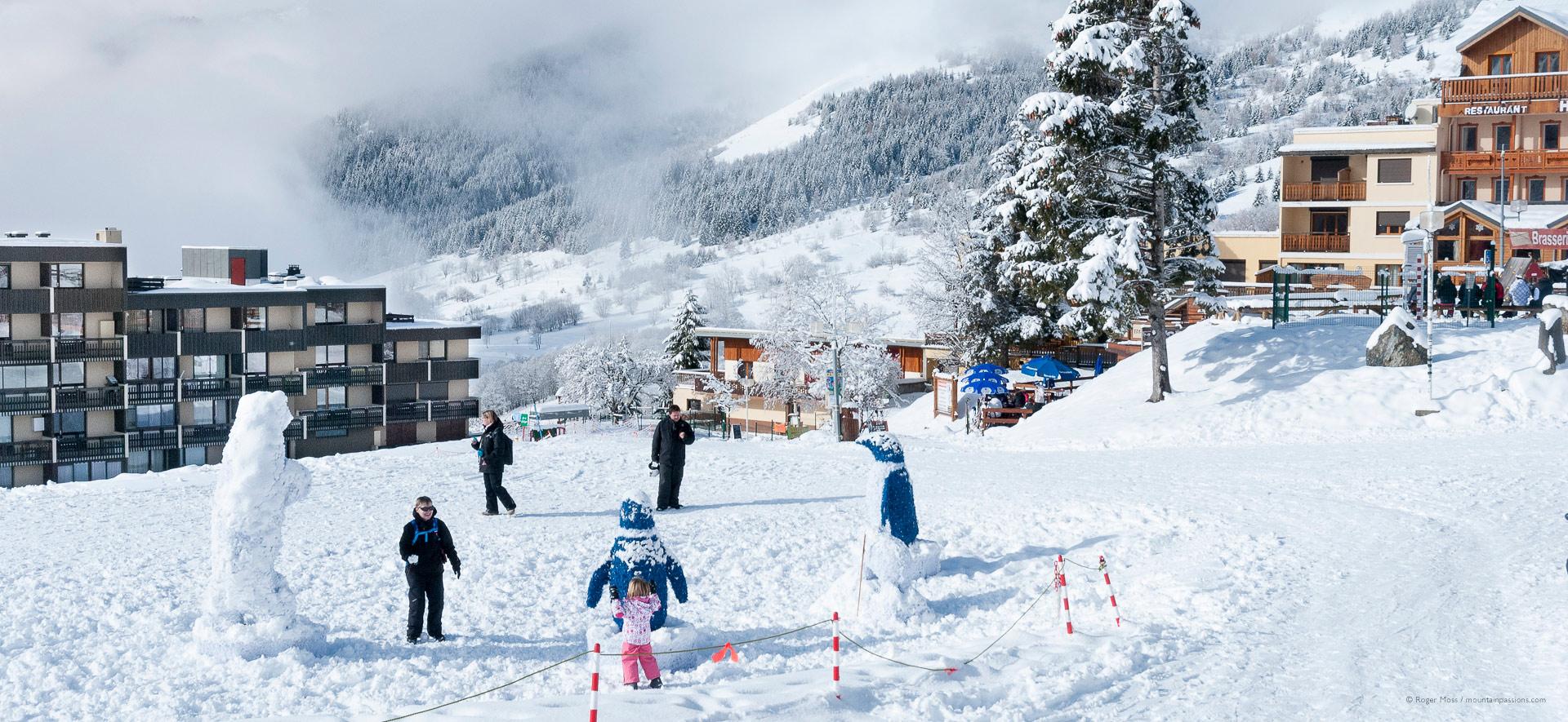 Families enjoying fresh snow at the ski village of Saint-Francois Longchamp.