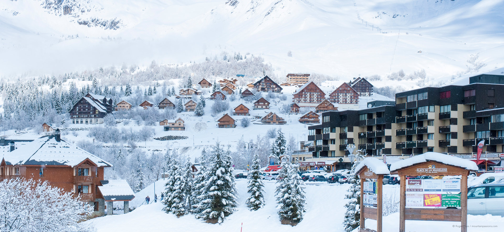 Fresh snow on chalets and trees of ski village of St Francois Longchamp.