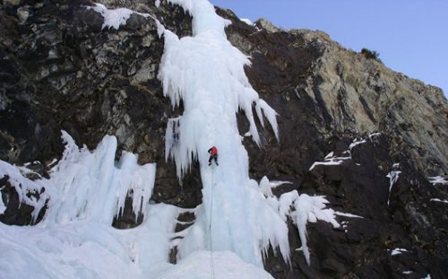 Frozen waterfall with ice climber.