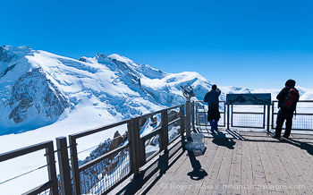 Visitors looking at Mont-Blanc from observation deck, Aiguille du Midi, above Chamonix, French Alps.