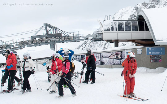 Group of skiers leaving top station of Planpraz gondola ski lift