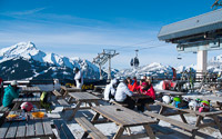 Skiers enjoying a relaxing lunch at La Terrase du Morclan, Chatel