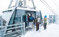 Skiers boarding the Vanoise Express, La Plagne