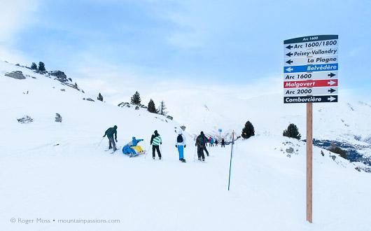 Signage, skiers, Les Arcs