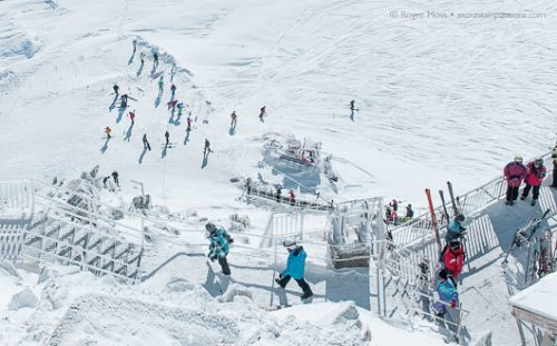 Skiers descend from the Grand Montets cable car, Argentière.