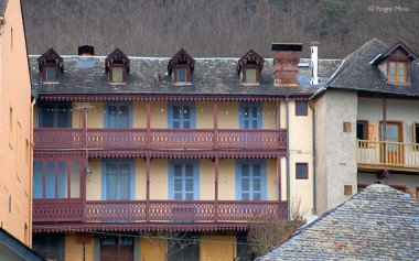 Argeles-Gazost, colourful building with balconies.