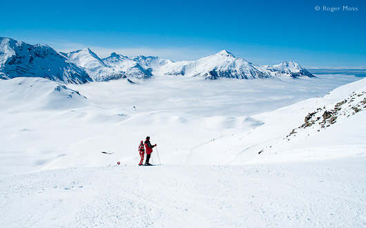 Orcieres, skiers on piste above clouds.
