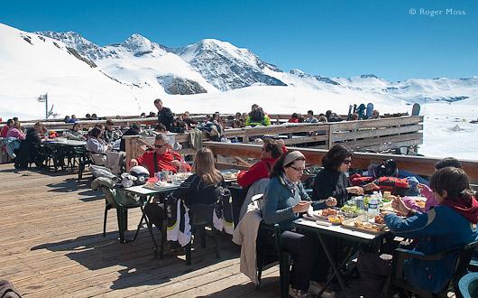 Diners enjoy the sun terrace of the Chalet de Rocherousse, Orcieres.