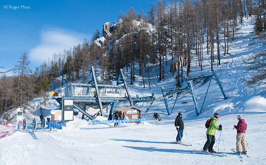 The Cote Chevalier chairlift hauls skiers up through the forest to a snowpark, boardercross and more, Serre Chevalier