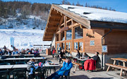 Chalet Pra Long bar restaurant with views over Briancon