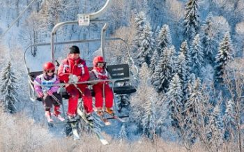 ESF instructor with children on ski lift at Velmeinier, French Alps
