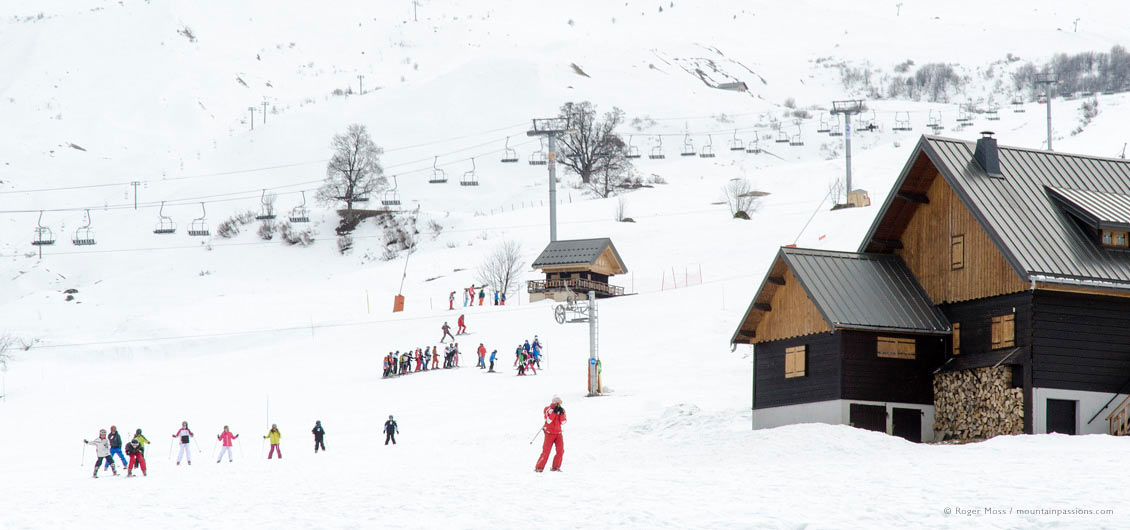 View of children's ski school groups on mountainside