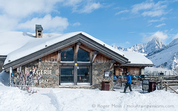 Side view of Bergerie Planpraz mountain restaurant with fresh snow