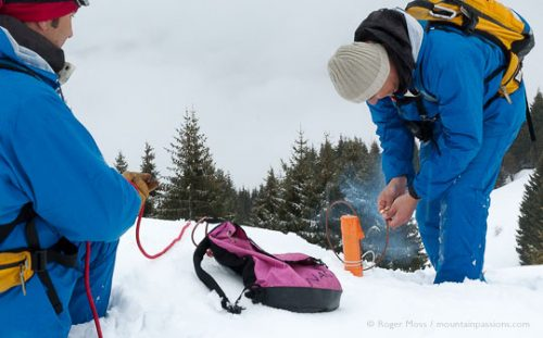 Avalanche team lighting fuse of explosive