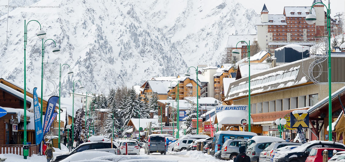 View of Les 2 Alpes ski resort village centre after snowfalls.