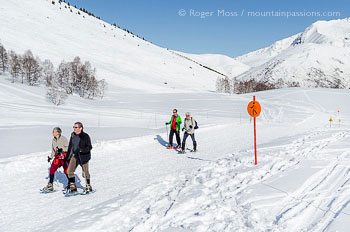 Snow-shoe walkers on marked trail at Les 2 Alpes