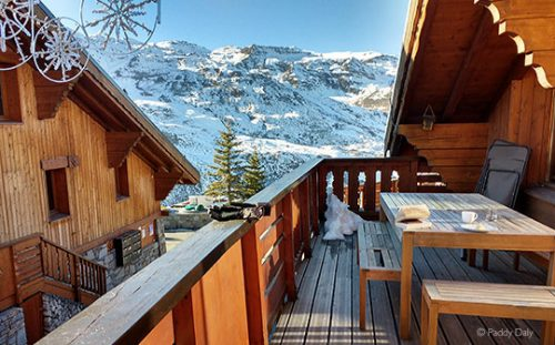 View from hot tub of chalet balcony and snow-covered mountains, Les Menuires