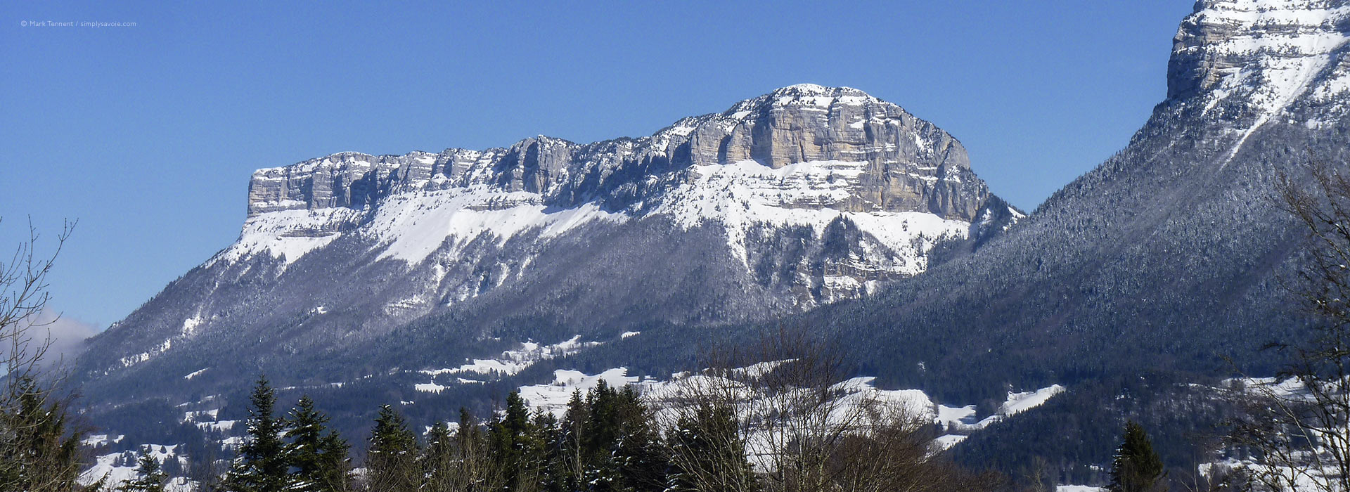 Wide view of snow-covered mountains and valley in Chartreuse Massif
