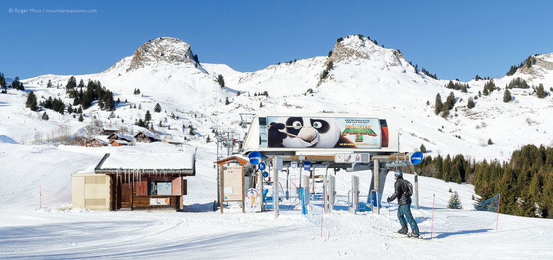Wide view of skier joining Haut Fleurie chairlift at Praz de Lys, French Alps.