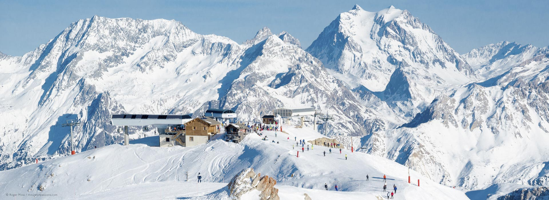 Long view of mountains with ski lifts at Courchevel, 3 Valleys, French Alps